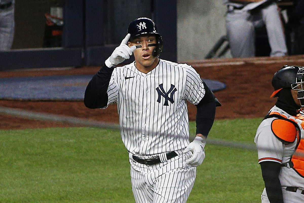 New York Yankees right fielder Aaron Judge reacts after hitting a solo home run against the Baltimore Orioles during the fourth inning at Yankee Stadium.