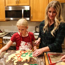 Camree Kirby, left, cuts cookie dough into pieces with her mom, Kristin, during a family night at the family's home in Lehi on Thursday, Dec. 17, 2020.