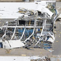 """An aerial view shows the damage to Spirit Aerosystems from Saturday's tornado in Wichita, Kan., Sunday, April, 15, 2012. The massive storm system that plowed through Kansas this weekend damaged businesses, uprooted trees, caused power outages and upended about 100 homes in a Wichita mobile home park. But no serious injuries or fatalities were reported, which one authority called """"pretty much a miracle."""""""