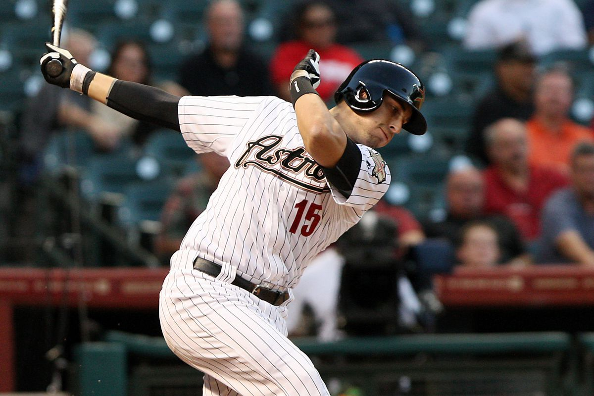 September 10, 2012; Houston, TX, USA; Houston Astros catcher Jason Castro (15) swings at a pitch in the first inning against the Chicago Cubs at Minute Maid Park. Mandatory Credit: Troy Taormina-US PRESSWIRE