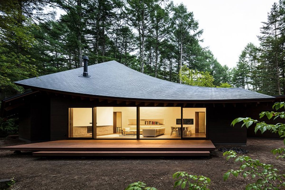 House with convex roof and large window