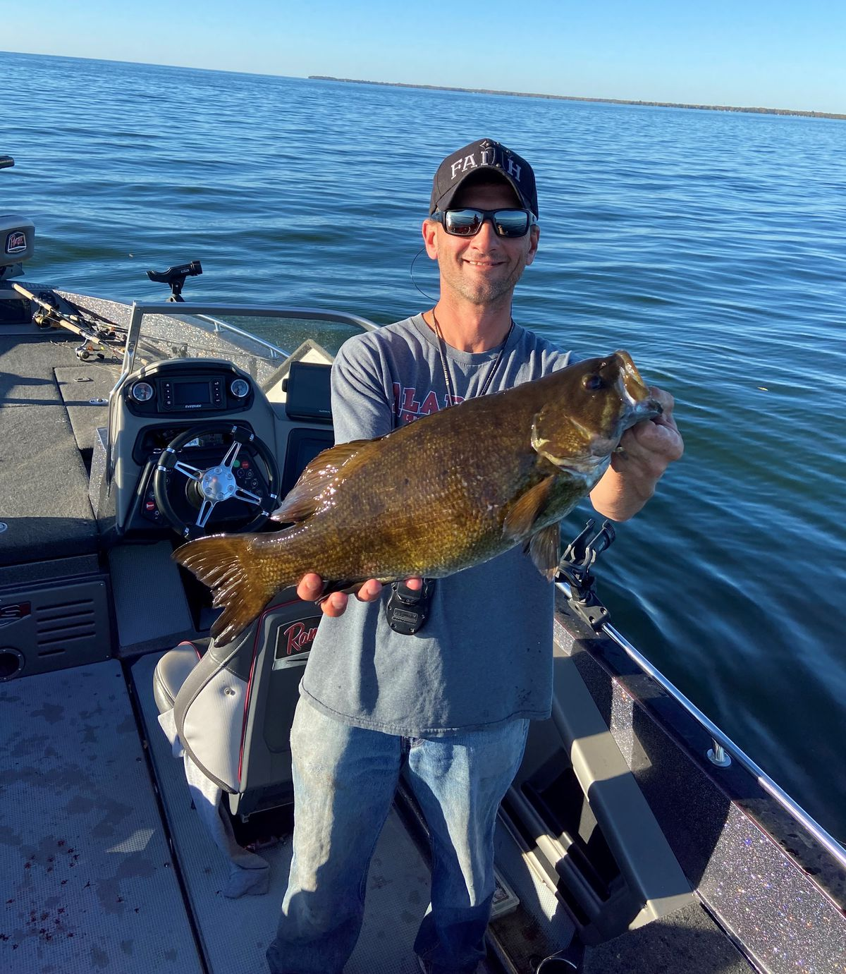 Tim Potoczny with a nice smallmouth bass from Mille Lacs. Provided by McQuoid's Inn