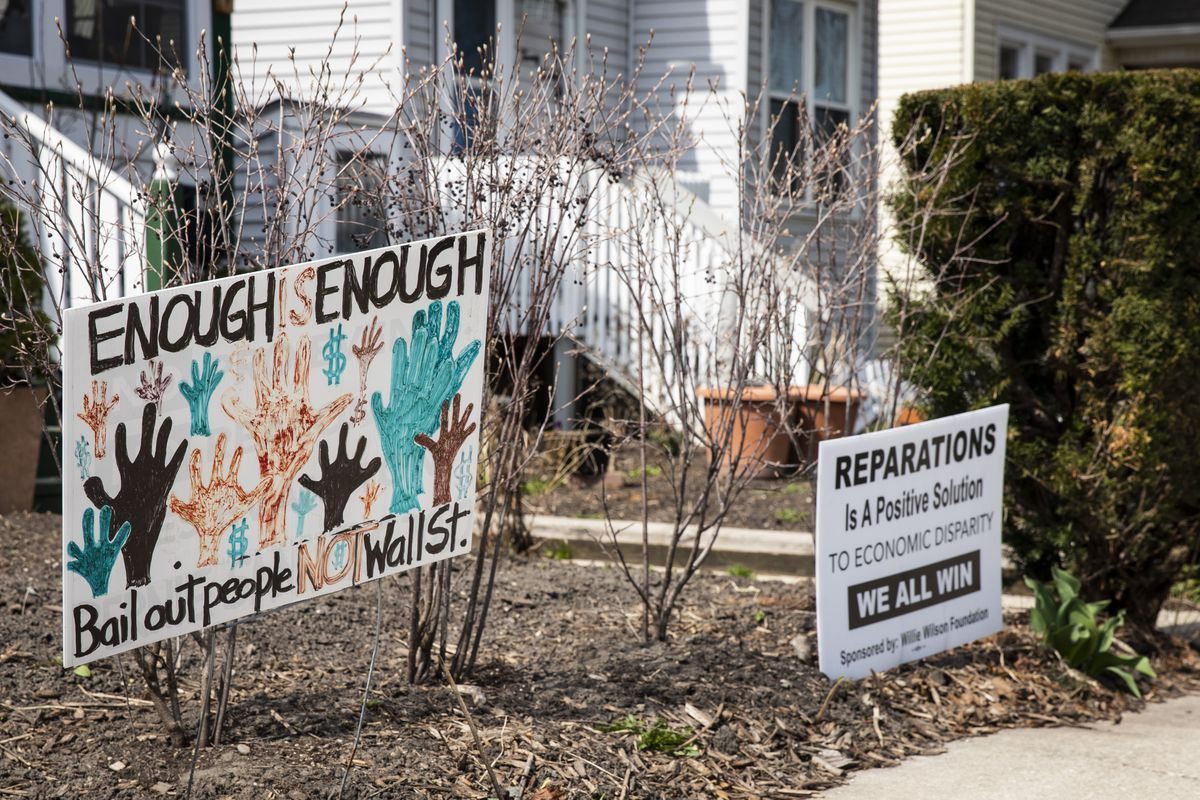 Yard signs in Evanston supporting reparations a week after the Evanston City Council approved a first-in-the-nation reparations plan.