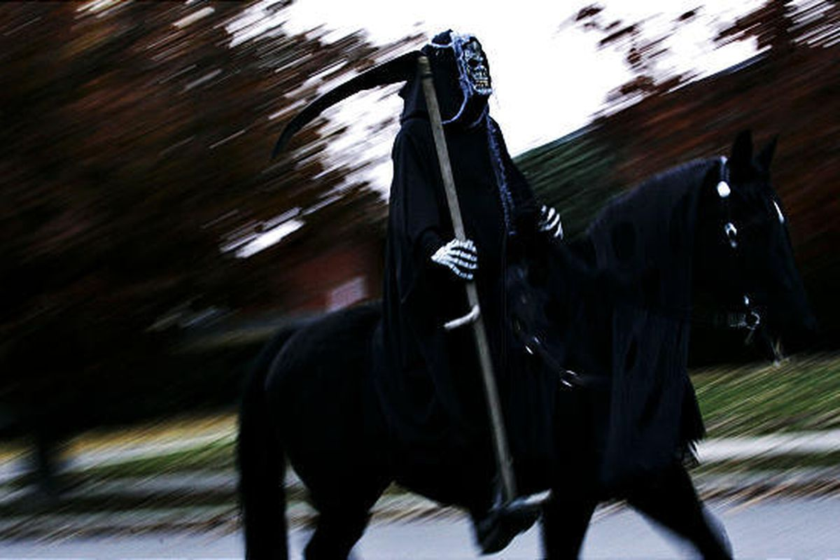 Wayne Carter rides his horse around a neighborhood in Sandy dressed as the Grim Reaper for Halloween on Friday. Last year, Carter delighted his neighbors by dressing as the headless horseman for the holiday.