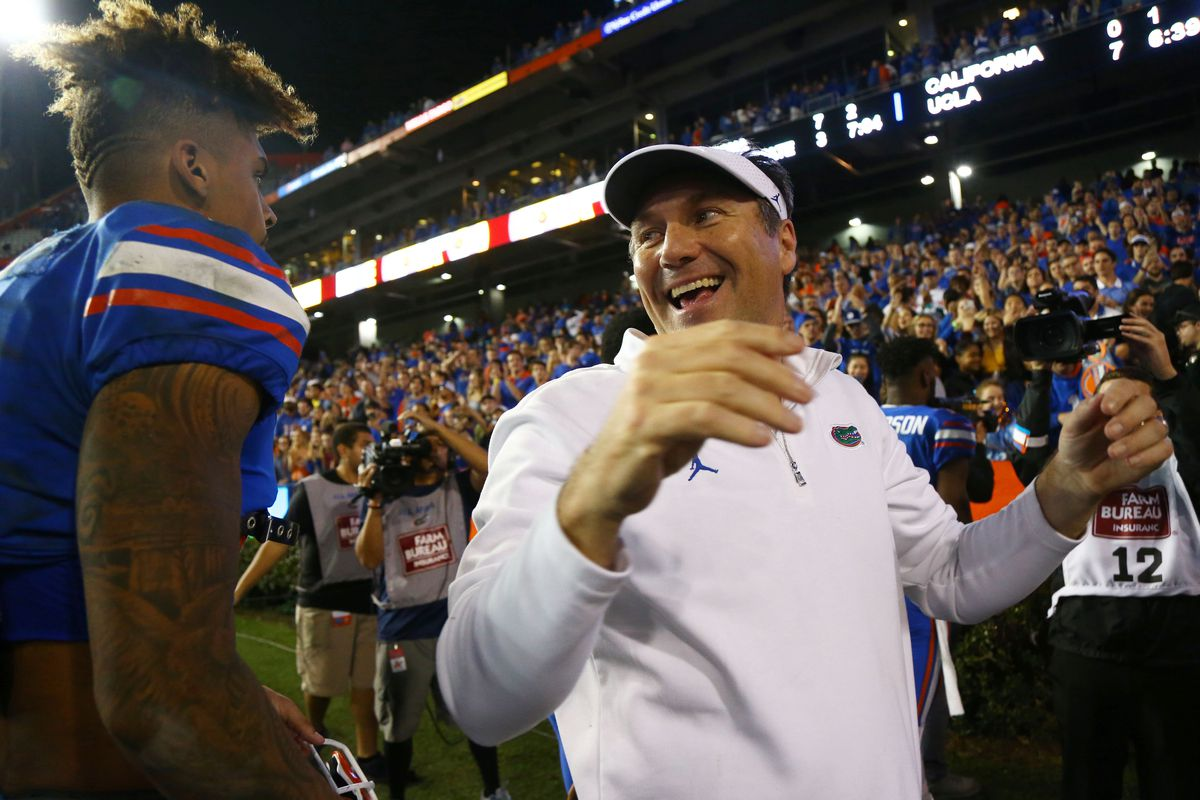 Florida Gators head coach Dan Mullen smiles with wide receiver Trevon Grimes as they beat the Florida State Seminoles at Ben Hill Griffin Stadium.