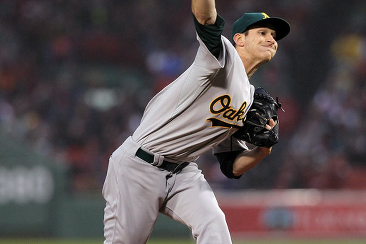 BOSTON, MA - MAY 1:  Jarrod Parker #11 of the Oakland Athletics throws against the Oakland Athletics at Fenway Park May 1, 2012  in Boston, Massachusetts. (Photo by Jim Rogash/Getty Images)