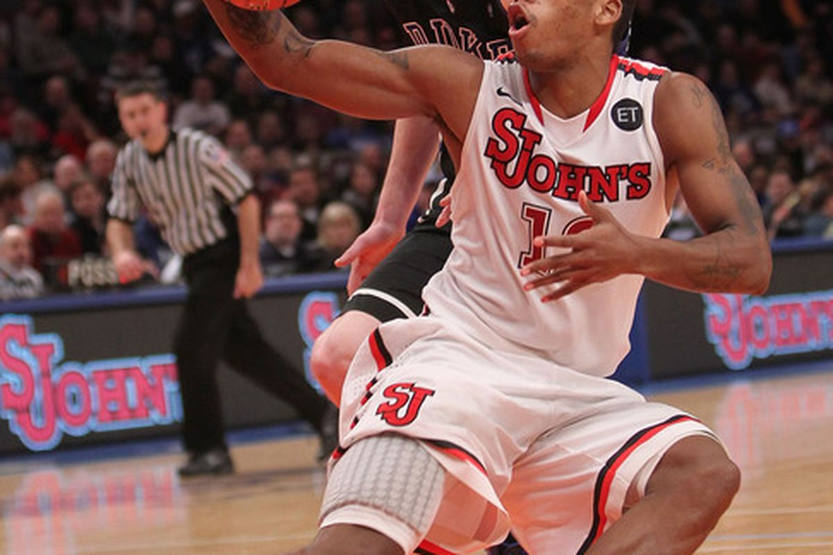 NEW YORK NY - JANUARY 30: Dwight Hardy #12 of the St. John's Red Storm fakes in front of Kyle Singler #12 of the Duke Blue Devils  at Madison Square Garden on January 30 2011 in New York City.  (Photo by Nick Laham/Getty Images)