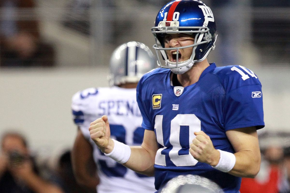 ARLINGTON, TX - DECEMBER 11:   Eli Manning #10 of the New York Giants celebrates a touchdown against the Dallas Cowboys in the fourth quarter at Cowboys Stadium on December 11, 2011 in Arlington, Texas.  (Photo by Ronald Martinez/Getty Images)