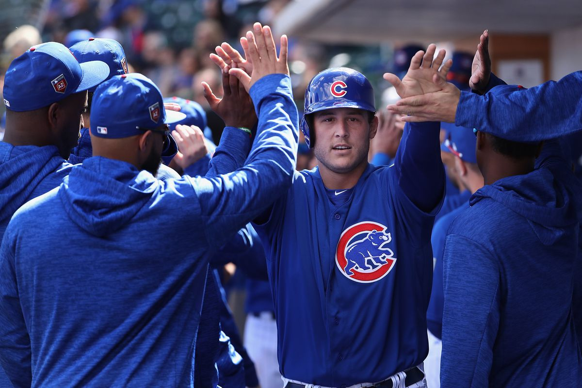 532ddabf7aa Anthony Rizzo  44 of the Chicago Cubs high fives teammates in the dugout  after scoring