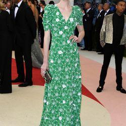 Elizabeth Debicki wears a Prada gown that — fun fact — is featured in the exhibition.