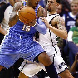 Deron Williams of the Utah Jazz works to defend Carmelo Anthony of the Denver Nuggets as the Jazz-Nuggets play in game 3 of the Western Conference Playoffs in Energy Solutions Arena.