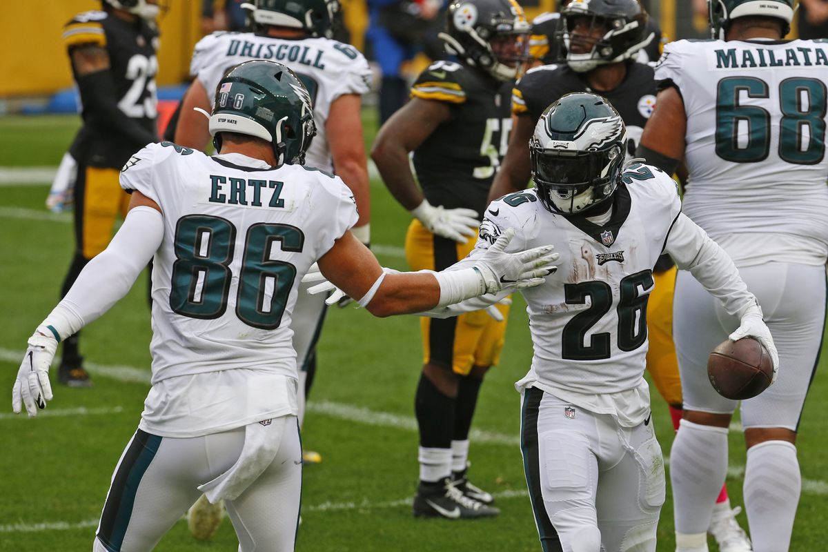 Miles Sanders #26 of the Philadelphia Eagles celebrates with Zach Ertz #86 after rushing for a 1 yard touchdown in the first half Pittsburgh Steelers on October 11, 2020 at Heinz Field in Pittsburgh, Pennsylvania.