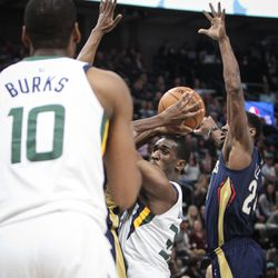 Utah Jazz center Ekpe Udoh (33) tries to pass the ball to guard Alec Burks (10) under the arm of New Orleans Pelicans guard Tony Allen (24) as Utah hosts New Orleans at Vivint Arena in Salt Lake on Friday, Dec. 1, 2017.