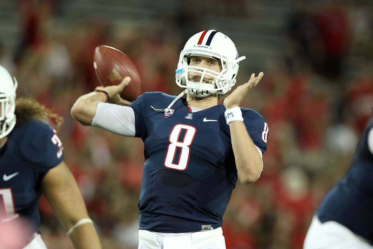 TUCSON, AZ - OCTOBER 20:  Quarterback Nick Foles #8 of the Arizona Wildcats throws a pass during the college football game against the UCLA Bruins at Arizona Stadium on October 20, 2011 in Tucson, Arizona.  (Photo by Christian Petersen/Getty Images)