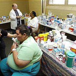Dr. Donna Cardin, left, of the LSU Health and Sciences Center talks with Cynthia Skipper, front right, who was being treated Thursday for breathing complications in the triage area at Hirsch Memorial Coliseum in Shreveport, La. The coliseum was being used to shelter refugees from Hurricane Katrina.