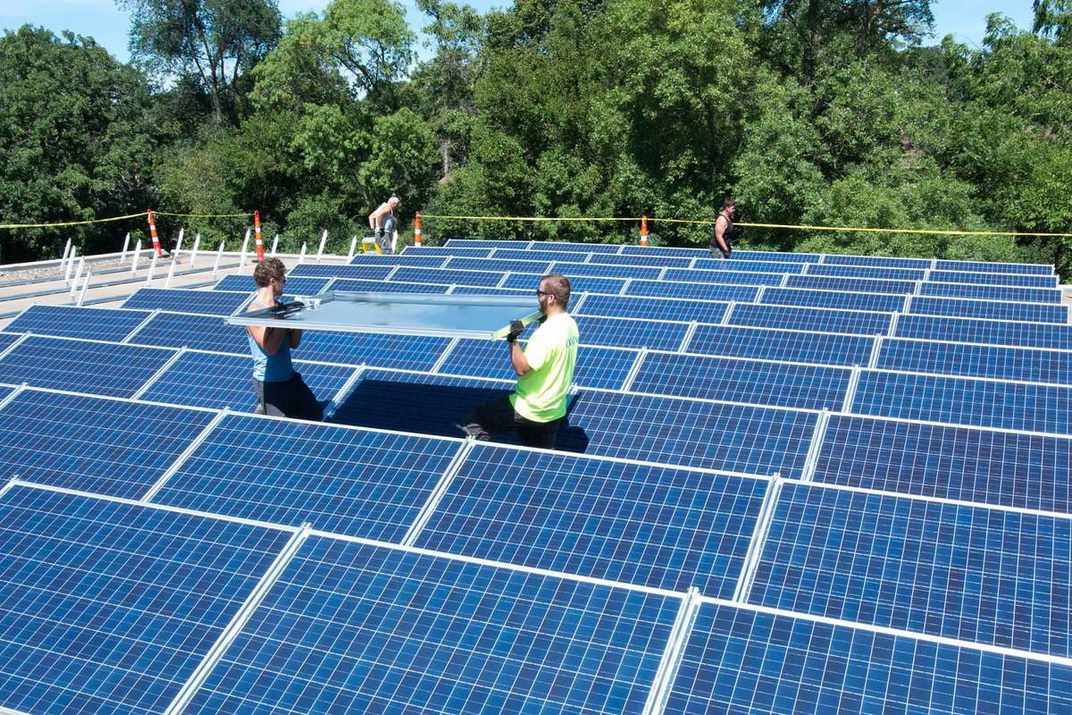 Assembling a shared solar project next to St. Luke Presbyterian Church, in Wayzata, Minnesota.
