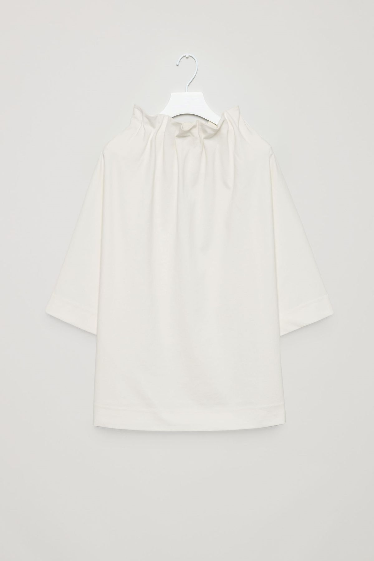 """""""Top with collapsing neckline."""""""