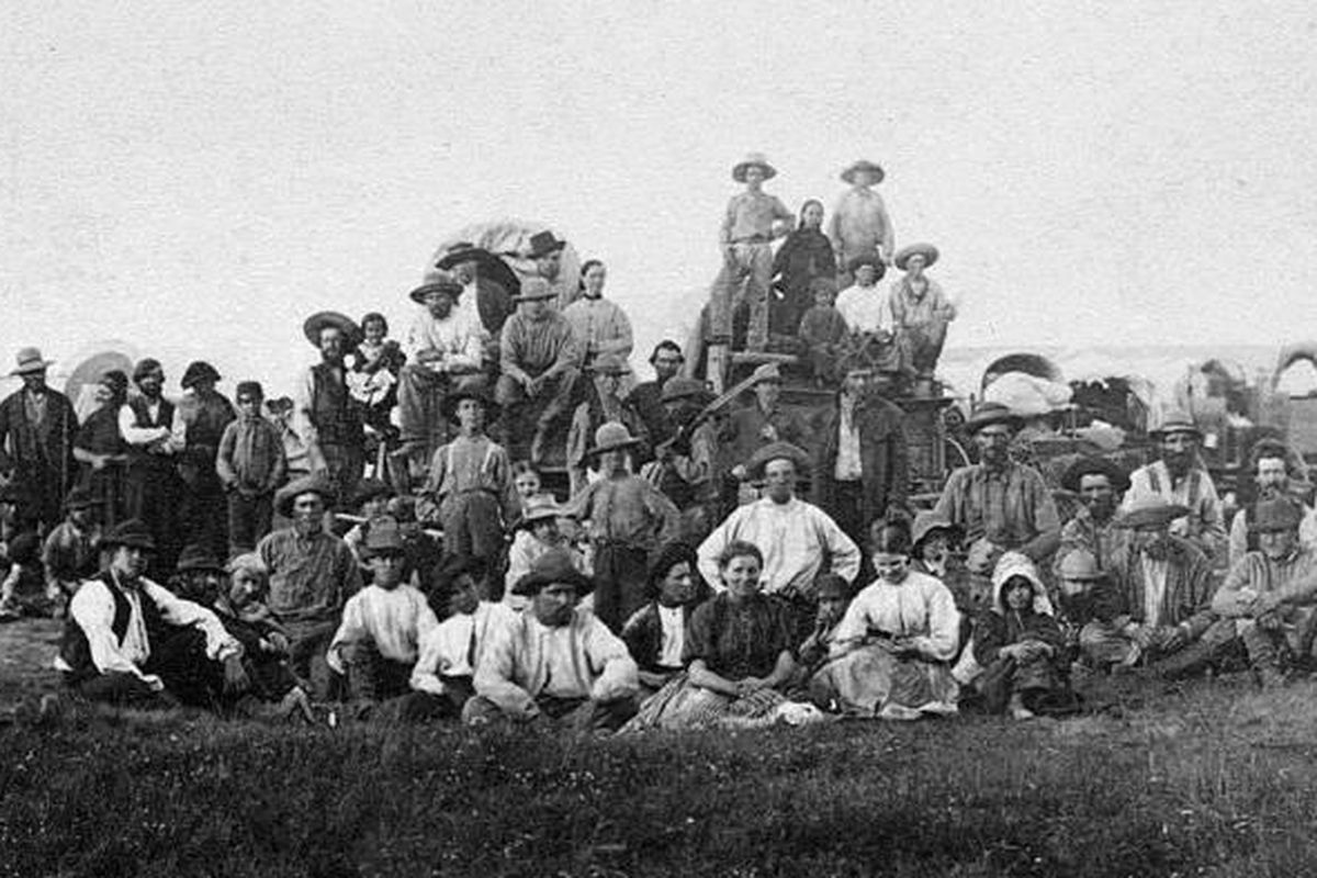 A group of Mormon pioneers is shown at South Pass, Wyoming, about 1859.