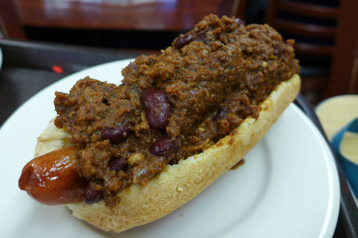 A hot dog in a bun loaded down with lots of chili con carne...