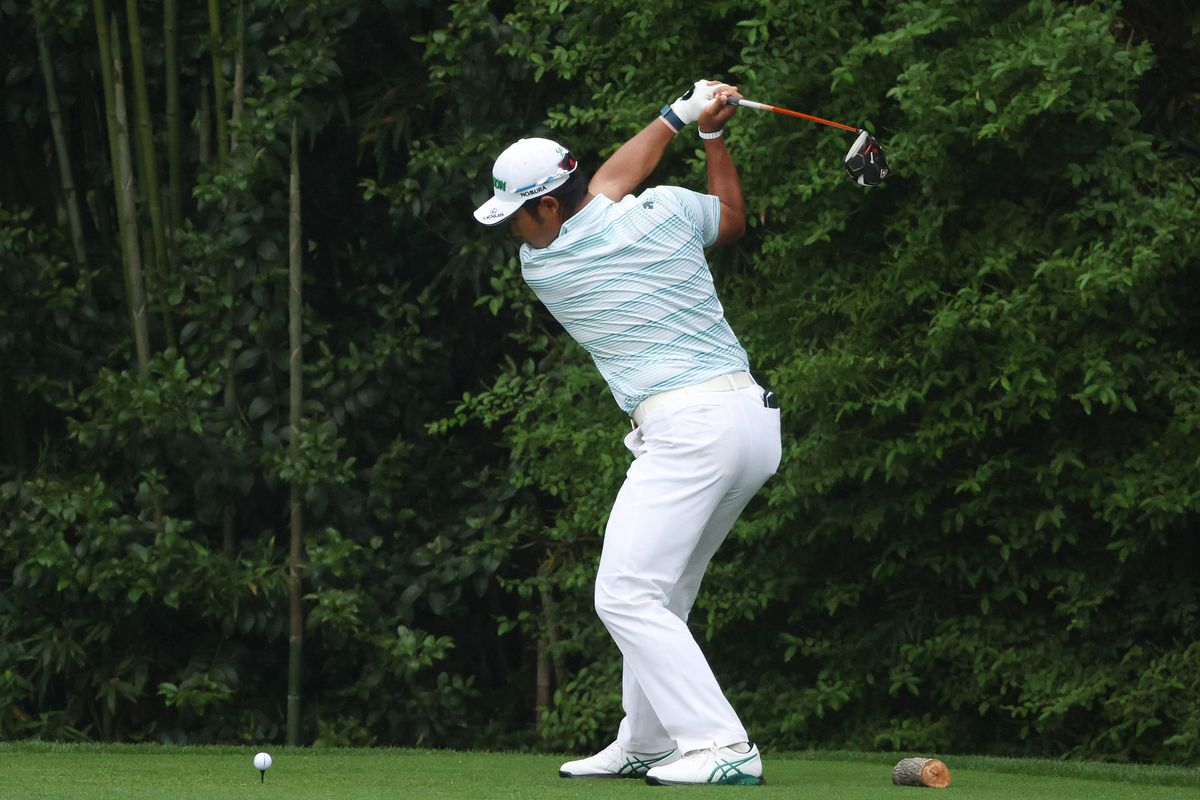 Hideki Matsuyama of Japan plays his shot from the 14th tee during the third round of the Masters at Augusta National Golf Club on April 10, 2021 in Augusta, Georgia.