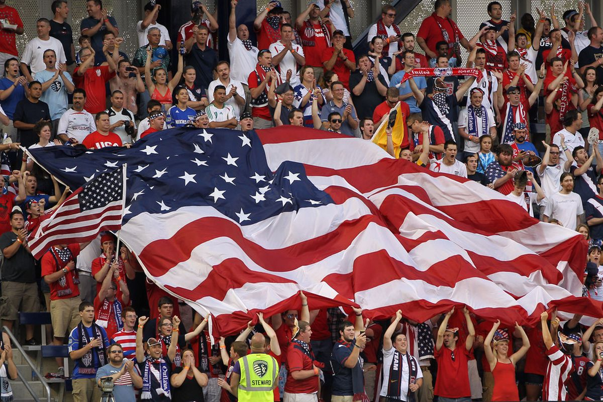 KANSAS CITY, KS - JUNE 14:  Fans cheer with a giant American flag prior to the start of the GoldCup game between the USA and Guadeloupe on June 14, 2011 at LiveStrong Sporting Park in Kansas City, Kansas.  (Photo by Jamie Squire/Getty Images)