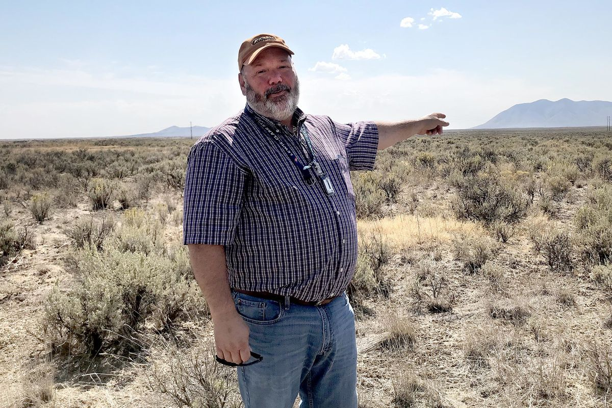 Don Miley, with the Idaho National Laboratory, gestures to a swath of land that may some day be home to the nation's first modular nuclear reactors. The NuScale Project is being pursued by the Utah Association of Municipal Providers to someday provide bas