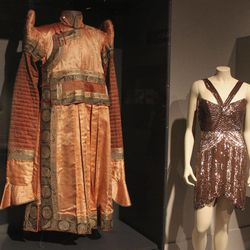 """In this Thursday, Sept. 13, 2012 photo, a brocaded Mongolian silk tunic called a """"deel"""" at left is seen next to a sequined chiffon shoulderless cocktail dress from the 2008 fall collection by fashion designer Maria Pinto in the new exhibit """"Fashion and The Field Museum Collection: Maria Pinto"""" opening Friday, Sept. 14 at the museum in Chicago. The exhibit features Maria Pinto designs alongside antiquities from the museum."""