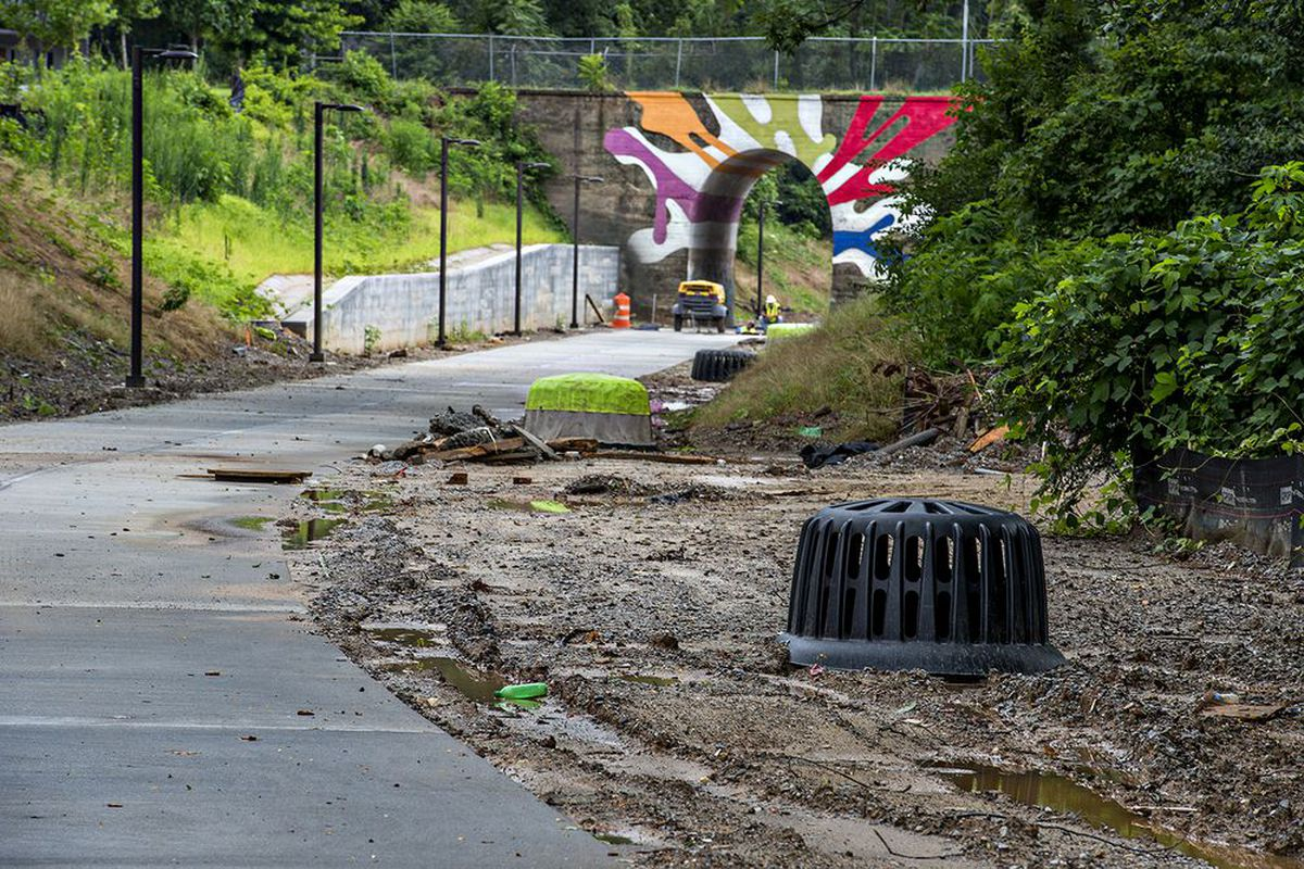 As seen last month, Westside Trail drainage pipes are covered with the Lucile Avenue bridge in the background.