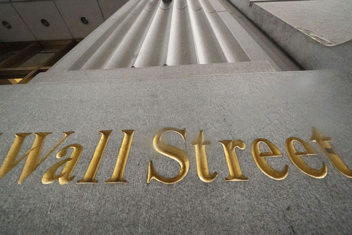 In this Nov. 5, 2020 file photo, a sign for Wall Street is carved in the side of a building.