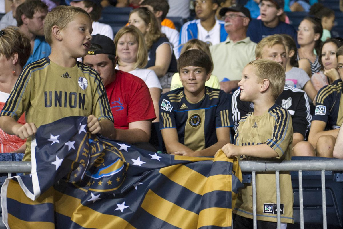These young fans line up to pay their respects to the recently departed.