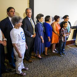 FILE —Community leaders and supporters stand behind Peter Corroon, Democratic state party chair in Utah, not pictured, as he discusses the urgency to expand Medicaid during a press conference at the Utah State Capitol in Salt Lake City on Tuesday, Aug. 18, 2015.