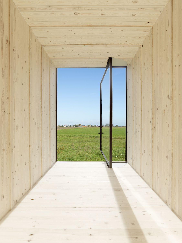 Pivoting door opening to field.