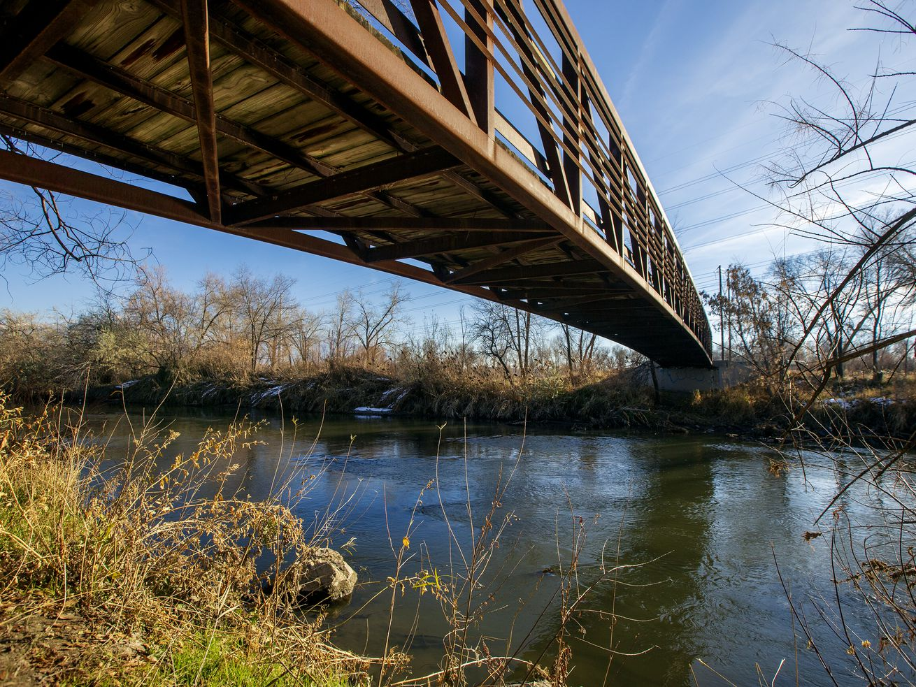 20181126 A bridge crossing the Jordan River at 3900 South in South Salt Lake is pictured on Monday, Nov. 26, 2018. A coalition of city and county leaders announced Monday they're taking the next steps to form the Jordan River Park, with boundaries from state Route 201 to about 4500 South along the river, will prioritize preserving the Jordan River Parkway's natural habitat while creating more recreation opportunities and better access for Salt Lake County families.