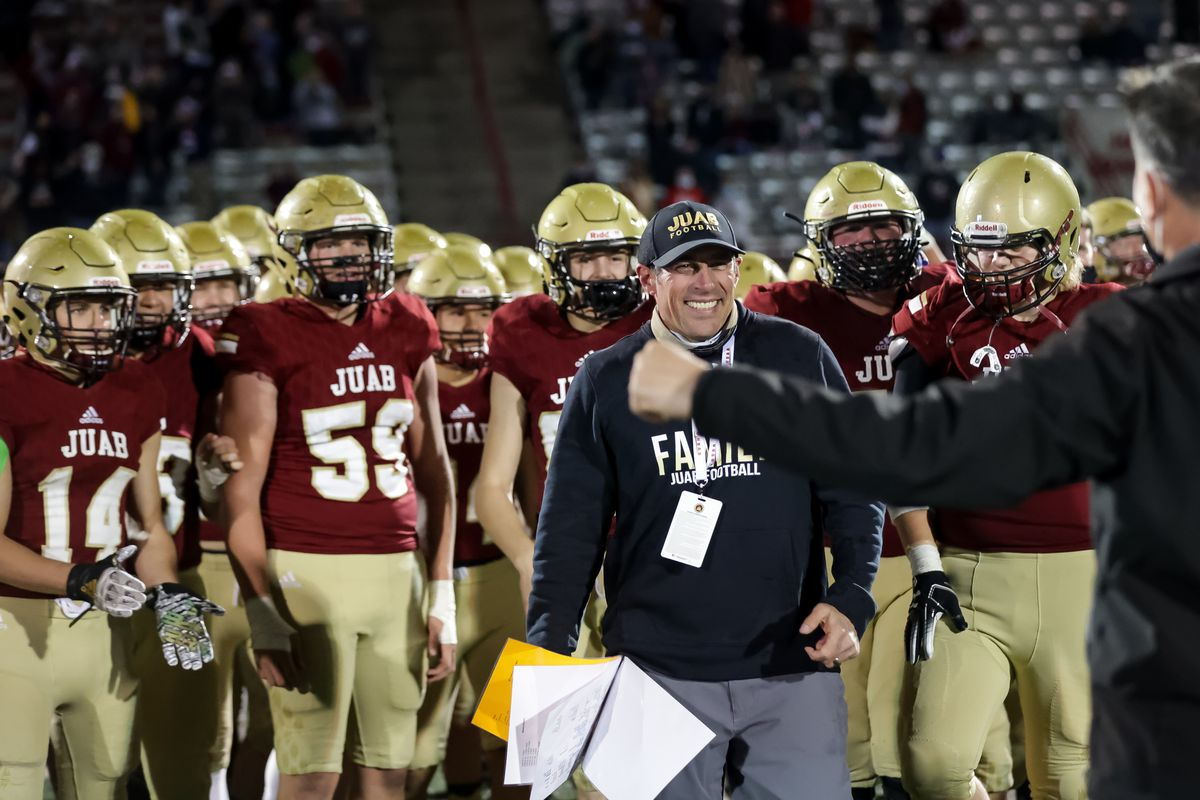 Juab coach Mike Bowring accepts his team's trophy after beating Morgan in the 3A football championship game at Dixie State University in St. George on Saturday, Nov. 14, 2020.