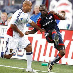 The Revolution's Kheli Dube, bottom, slide tackles Real Salt Lake's Will Johnson during their MLS contest Sunday.