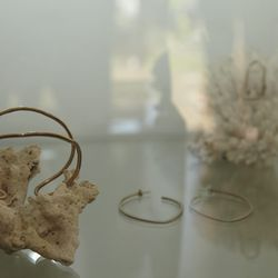 More earrings and the designer's Delicate Wire Cuff in bronze.