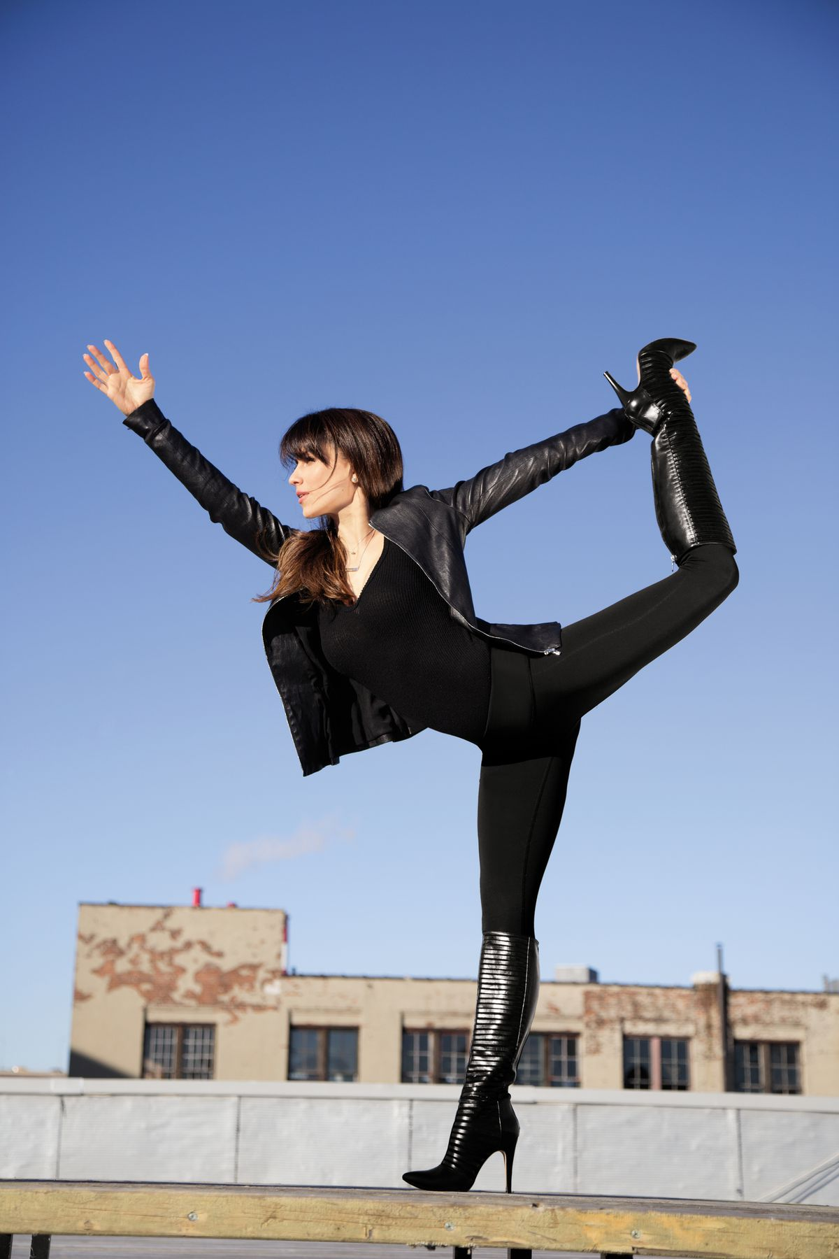 Hilaria Baldwin believes in striking a yoga pose wherever and whenever the mood strikes you. | COPYRIGHT RODALE BOOKS