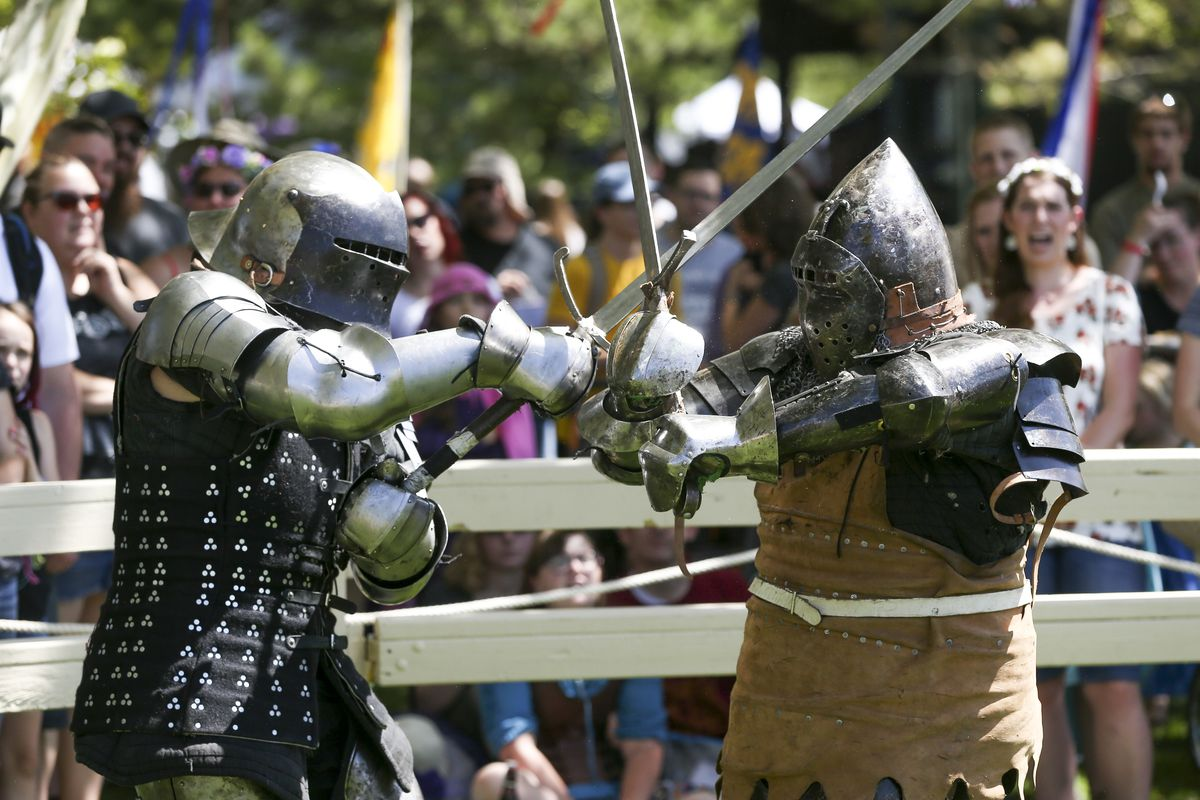 A pair of fighters with the Armed Combat League compete during the Utah Renaissance Faire at Thanksgiving Point's Electric Park in Lehi on Friday, Aug. 23, 2019.