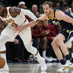 Cleveland Cavaliers forward Jae Crowder (99) and Utah Jazz forward Joe Ingles (2) rush for a loose ball during the game at Vivint Arena in Salt Lake City on Saturday, Dec. 30, 2017.