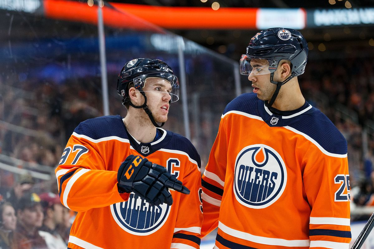 EDMONTON, AB - APRIL 05: Connor McDavid #97 and Darnell Nurse #25 of the Edmonton Oilers strategize during a break in play against the Vegas Golden Knights at Rogers Place on April 5, 2018 in Edmonton, Canada.
