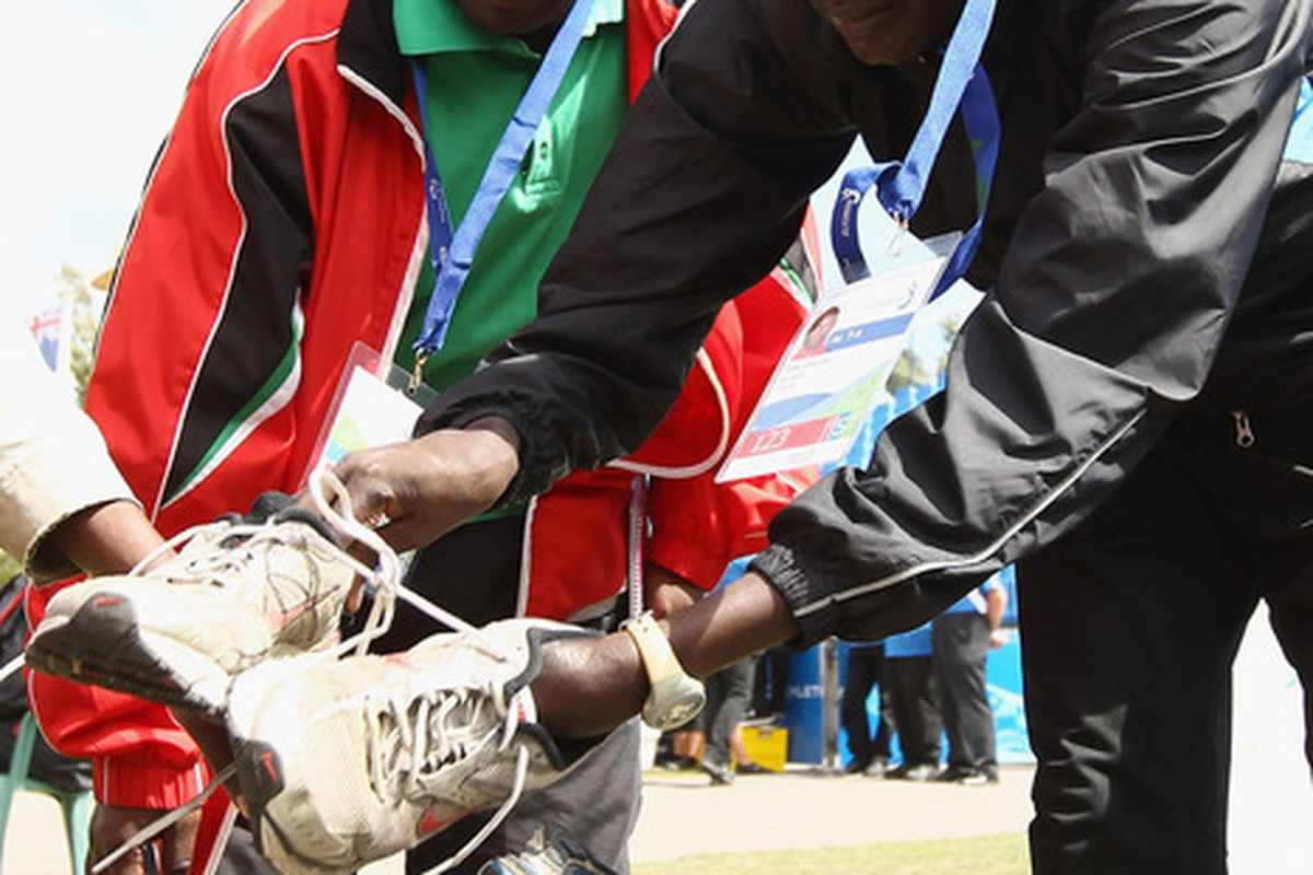 CHRISTCHURCH NEW ZEALAND - JANUARY 28:  Kenyan athletes choose shoes donated to the team during day seven of the IPC Athletics Championships at QE II Park on January 28 2011 in Christchurch New Zealand.  (Photo by Hannah Johnston/Getty Images)