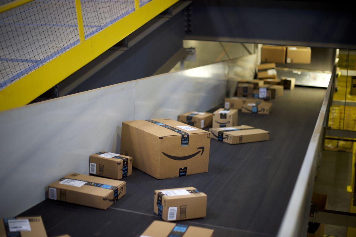 Amazon shipping boxes on a conveyor belt.