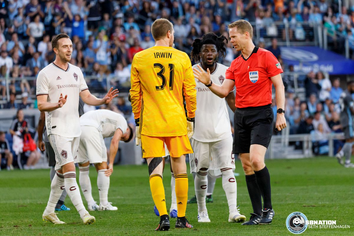 August 14, 2019 - Saint Paul, Minnesota, United States - Colorado players argue with the referee Drew Fischer over a penalty kick call made during the Minnesota United vs Colorado Rapids match at Allianz Field.