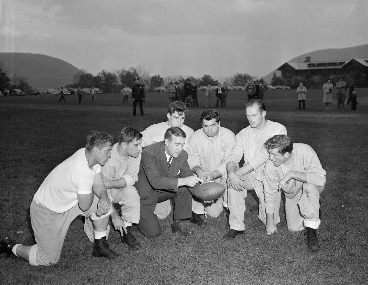 Frank Leahy with Notre Dame Team in Huddle