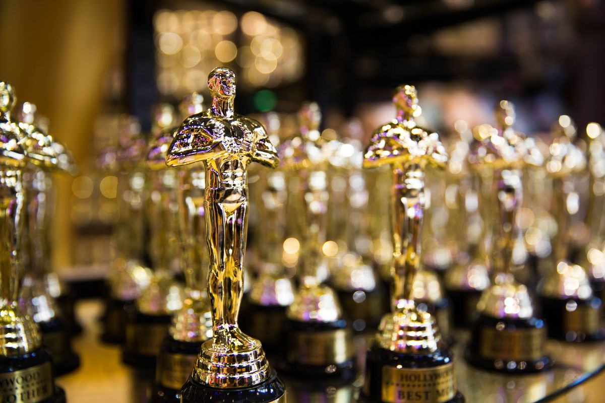 Multiple rows of golden Academy Awards trophies, shown close up