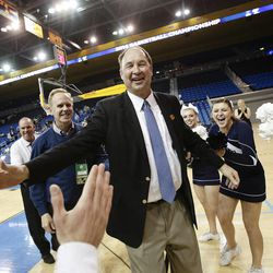 BYU head coach Jeff Judkins, center, celebrates the team's 80-76 win against Nebraska in a second-round game of the NCAA women's college basketball tournament on Monday, March 24, 2014, in Los Angeles. (AP Photo/Jae C. Hong)