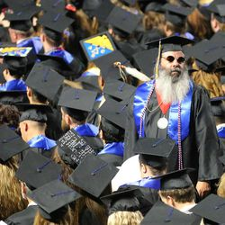 An unidentified student stands to look for family members during Salt Lake Community College's commencement ceremony at the Maverik Center in West Valley City on Friday, May 6, 2016.