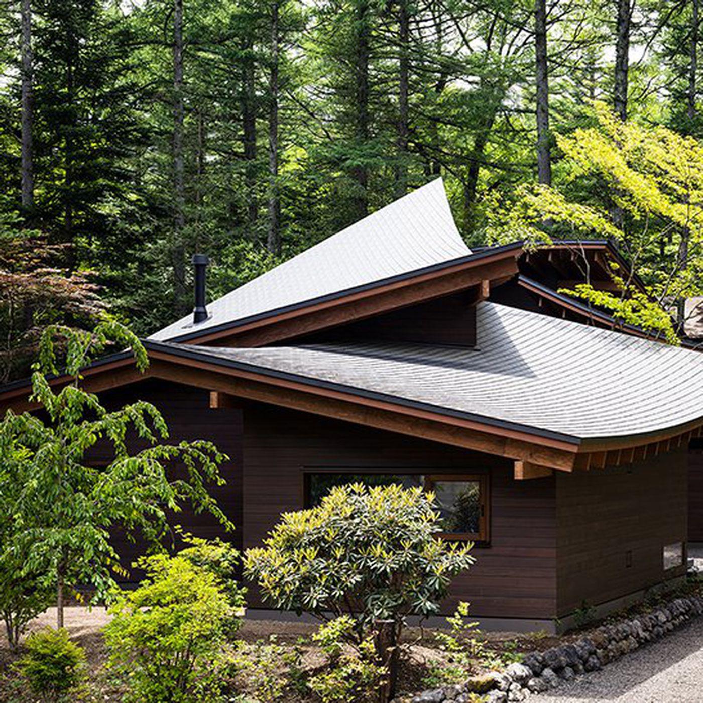 Modern House In Japan Looks Like Fallen Leaves Curbed