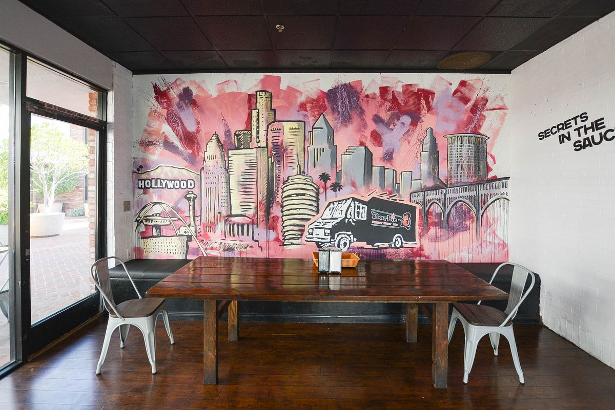A pink city mural on a wall.