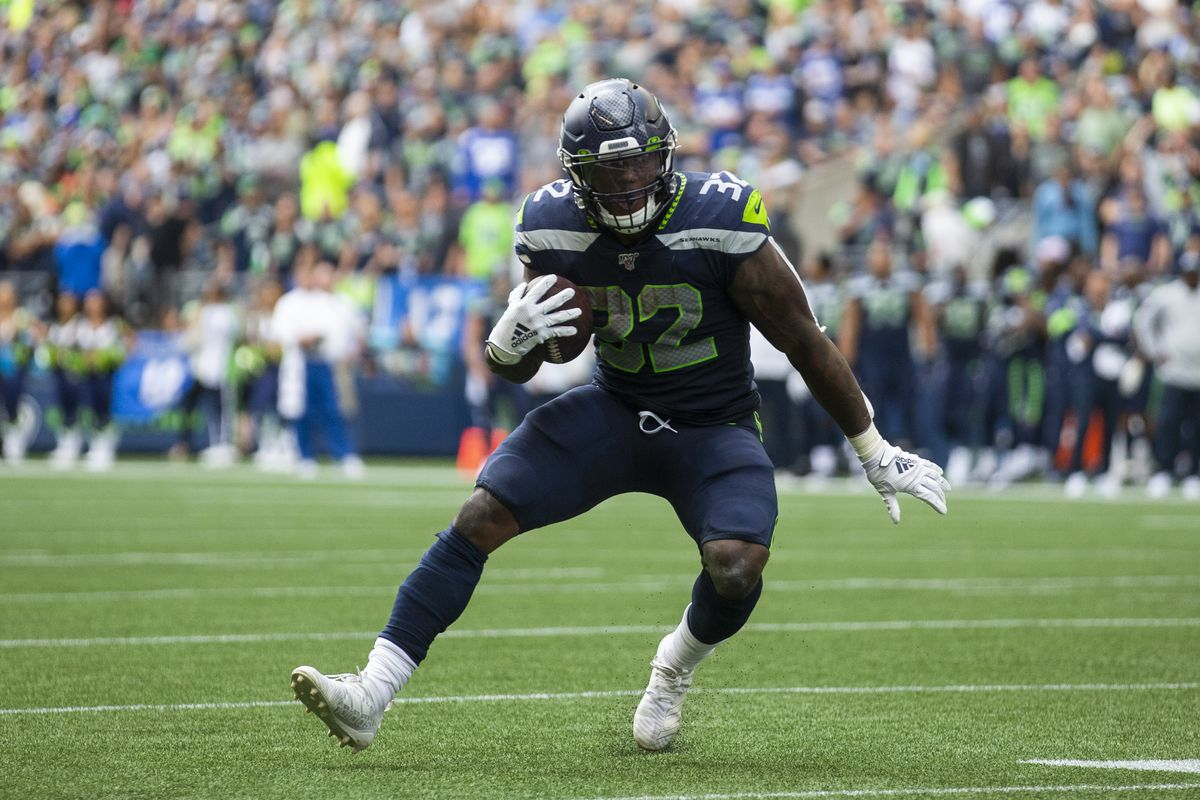 Chris Carson of the Seattle Seahawks rushes to score a 10 yard touchdown in the second quarter against the Cincinnati Bengals at CenturyLink Field on September 8, 2019 in Seattle, Washington.